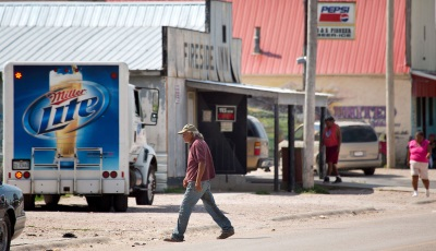 A beer truck in front of a liquor store in Whiteclay NE
