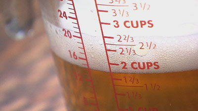 A measuring cup full of beer